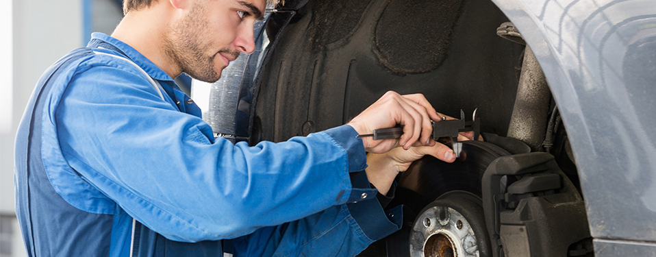 Mechanic fitting new brake pads - Brakes Chorley
